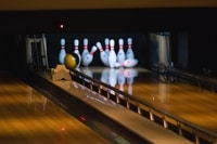 A bowling night is a fundraiser for your sports team that all participants can enjoy.