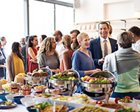 A community dinner promotes bonding and can be a great sports team fundraiser.